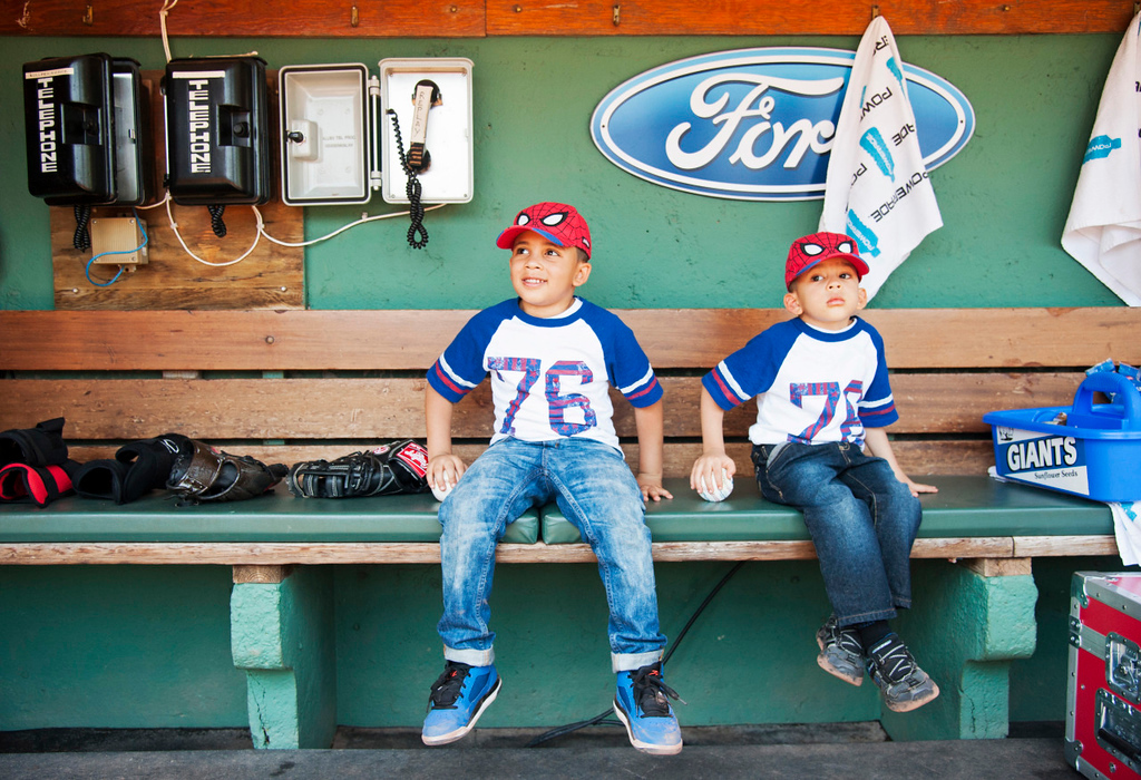 Two brothers sit in the dugout before the game against the Los Angeles Angels on May 24, 2015.