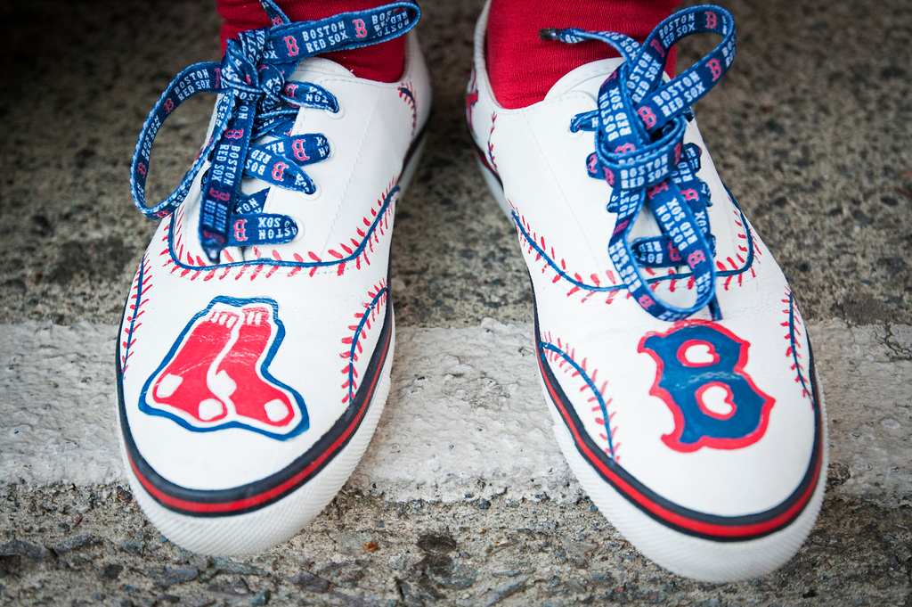 A fan sports her new shoes on Yawkey Way before the game against the Los Angeles Angels on May 22, 2015.