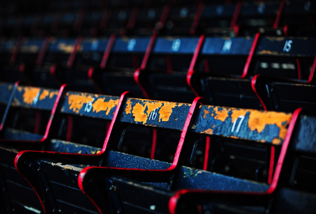 Paint peels off of the stadium chairs in Fenway park prior to opening day on April 9, 2015.
