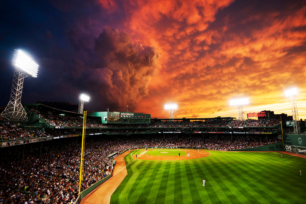 The sun sets over Fenway Park following a tornado warning during the game against the Baltimore Orioles on June 23, 2015.