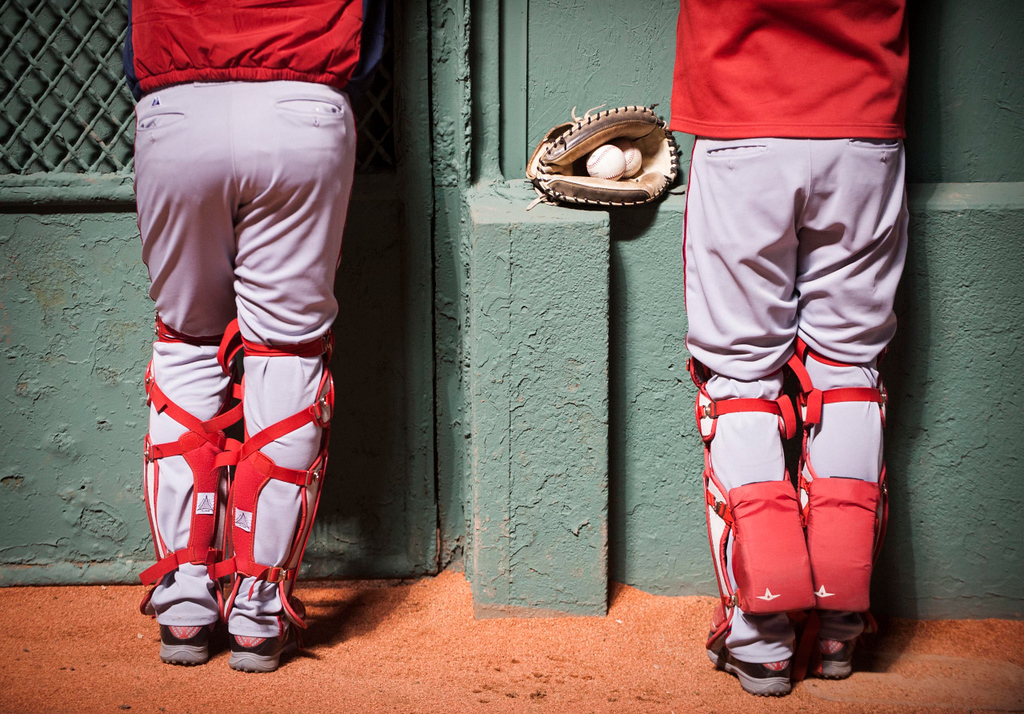 Back-up catchers watch the action from the bullpen during the game against the Washington Nationals on April 14, 2015.