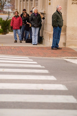 Record-Eagle/Jan-Michael Stump<br /> Extras wait for their cue to walk down the street during filming on East Front Street.