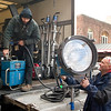 Record-Eagle/Jan-Michael Stump<br /> Electricians Brian Posslenzny, left, and Bill Wauer work on lighting equipment during filming.