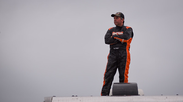 Tim Shaffer watches qualifying from atop his trailer.