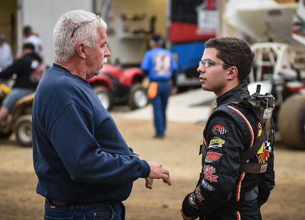 Pennsylvania legend Fred Rahmer (left) talks with son Freddie (right) prior to time trials.