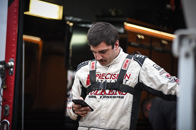 Aaron Reutzel intently watches race monitor during time trials.