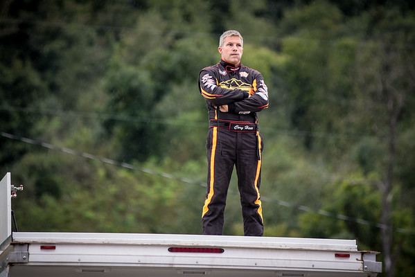 Cory Haas stands atop his trailer in light rain.