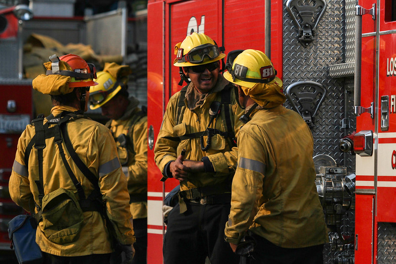 John Chaides / Courier<br /> Firemen with station 81 talk about the fire during the Skirball Fire on Wednesday, December 6, 2017.