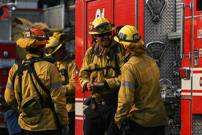 John Chaides / Courier Firemen with station 81 talk about the fire during the Skirball Fire on Wednesday, December 6, 2017.
