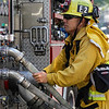 John Chaides / Courier<br /> A fireman adjusts the water presure during the Skirball Fire on Wednesday, December 6, 2017.