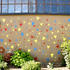 Record-Eagle/Vanessa McCray<br /> Dozens of hearts in primary colors decorate the side of a Warehouse District building in Traverse City.