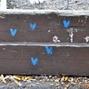 Record-Eagle/Vanessa McCray<br /> A constellation of tiny blue hearts is painted on boards in a courtyard area off East Front Street.