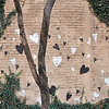 Record-Eagle/Vanessa McCray<br /> Black and white hearts are painted on a brick wall in a courtyard area off East Front Street.