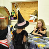 Record-Eagle/Vanessa McCray<br /> Elizabeth Steed, 11, explains the rules of a game to costumed players.