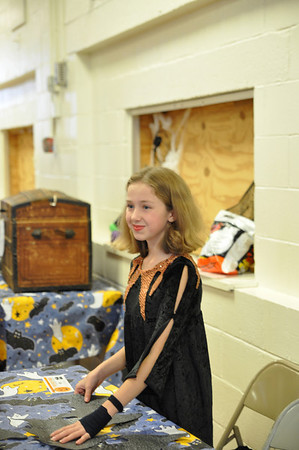 Record-Eagle/Vanessa McCray<br /> Elizabeth Steed, 11, oversees one of the games.