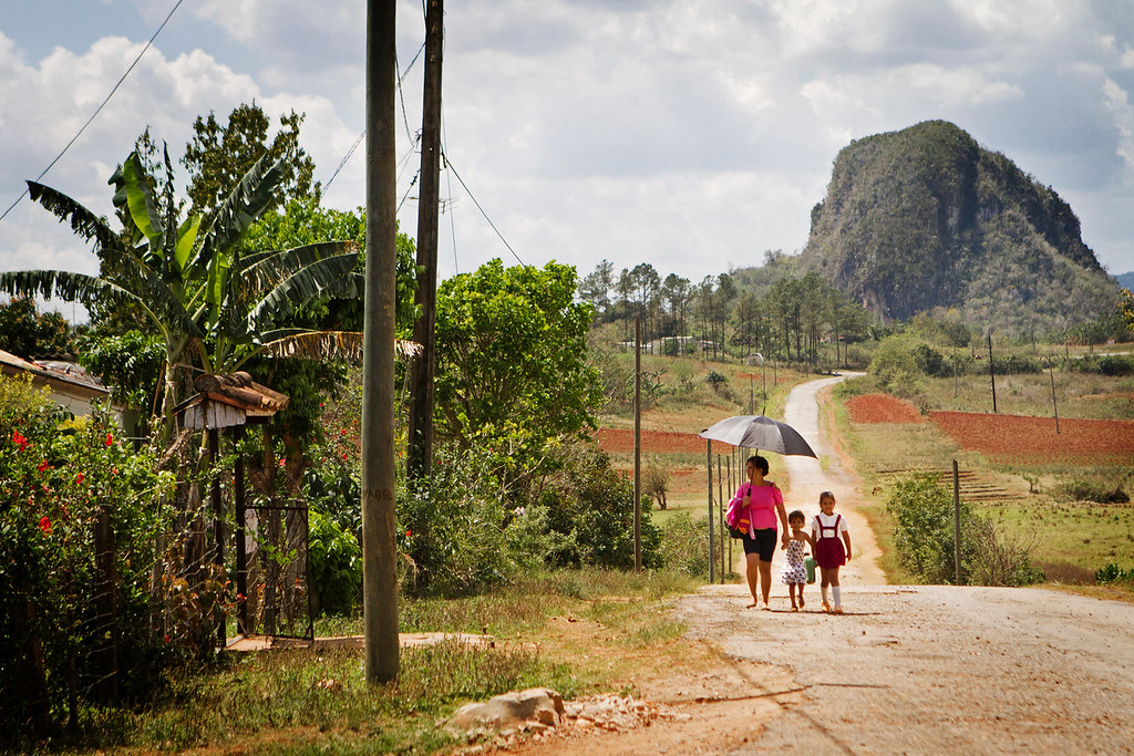 A mother walks her children home after school a few miles outside of Viñales, Cuba.