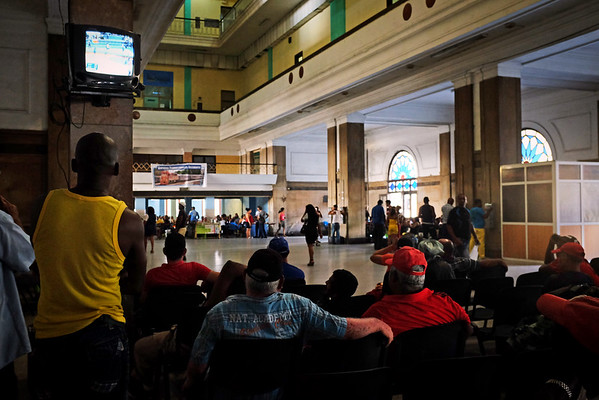 Passengers watch TV while they wait to board the train at the Central Station in Havana.