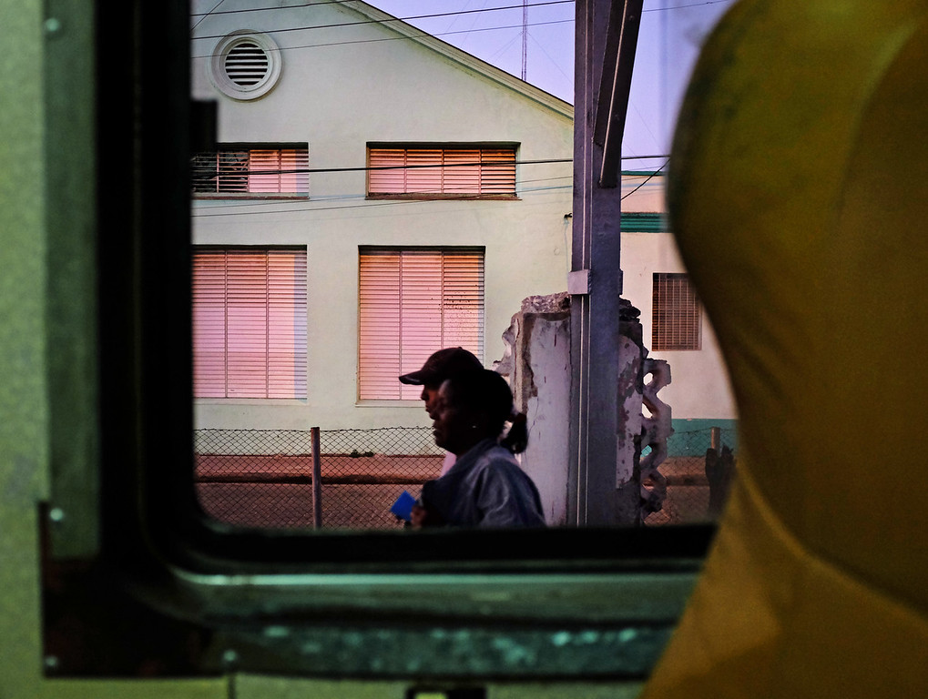 A couple exit the train car in Camagüey, Cuba during the ride from Havana to Santiago de Cuba.