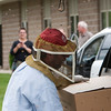 Record-Eagle/Douglas Tesner<br /> Bystanders watch in amazement as beekeeper Mike Street removed two  clusters of bees from a tree in front of Stromberg-Carlson engineering office. He loaded the more than 100,000 bees into the back of his SUV.
