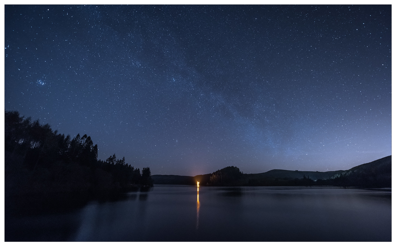 The stars and faint Milky Way over Lake Vyrnwy in north Wales.