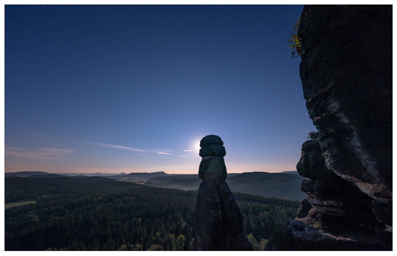 Unique rock structures at twilight in Saxony, Germany.