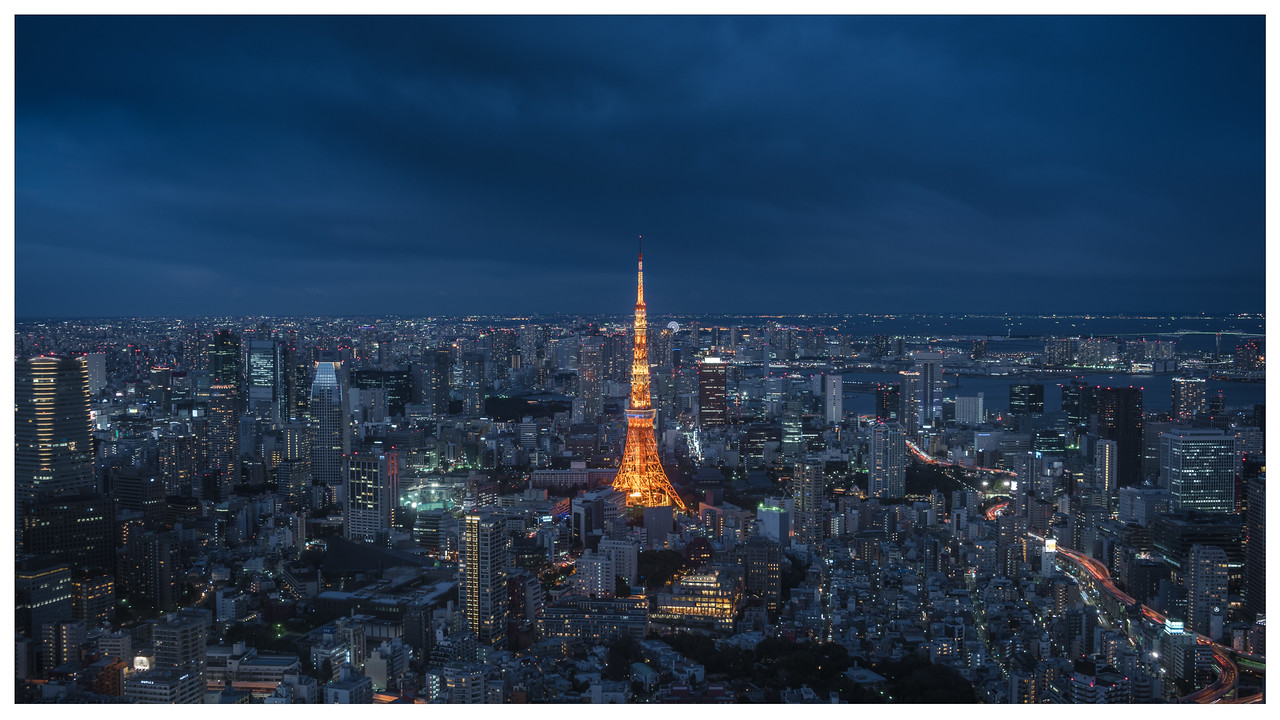 A blue hour shot of the Tokyo Tower and surrounding cityscape in Tokyo, Japan.