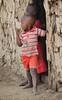 Maasai boys in doorway of hut