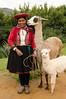 woman with llama and baby alpaca, Cusco, Peru