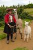 native woman with Llama and baby alpaca, Cusco, Peru