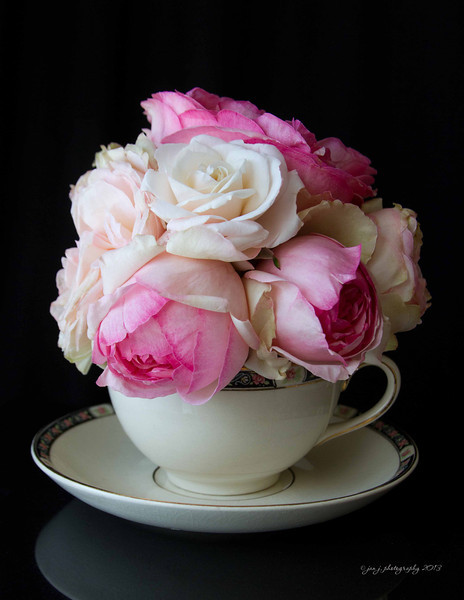 April 1 - More than just April Fool's Day, today was my late Grandmother's birthday...so today we have my pink roses in Grandma's teacup.