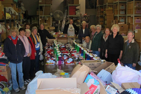 "January 29 - Today's outing with Mom took us to ""Love Lift Ministries"" to drop off the items she sews & knits for them.  These folks (several who were between 85-95) were in the warehouse packing up supplies for missions."