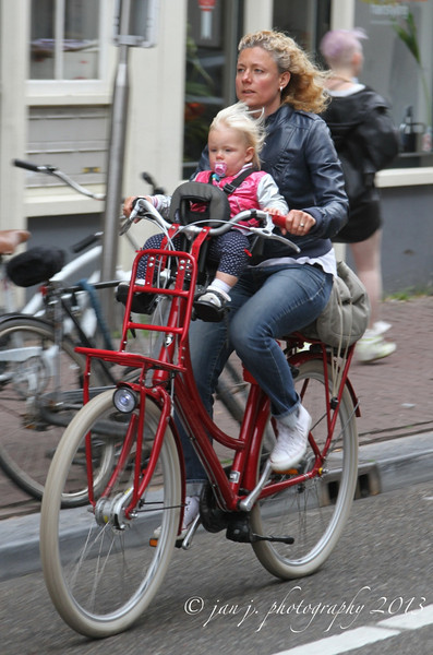 June 21 - We walked miles today in Amsterdam, most of it in the rain.  I took tons of pictures of bicycles, but my favorites were of moms with their kids - sometimes 2 kids on their bikes...Dutch women rock!