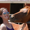 July 29 - My daughter at the horse rescue where she volunteers.