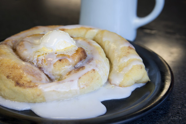 April 10 - I don't usually post photos of what I eat unless I've made it.  However this was a 'must' on our farewell tour.  A plate-sized Cinnamon Roll at Paul's Pantry...I savored every calorie filled bite.<br /> <br /> #CY365 - Currently Loving