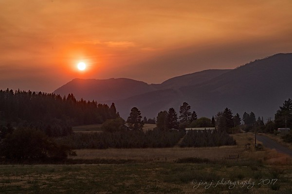 September 11 - A smokey sunset here in the Northwest.  We're thankful the skies are beginning to clear.<br /> <br /> Porthill, ID