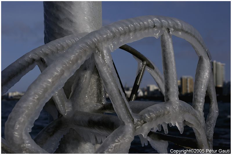 06 April. Frost on a hose-hanger by the docks of Reykjavík. This is frozen spray from the sea. Cold.