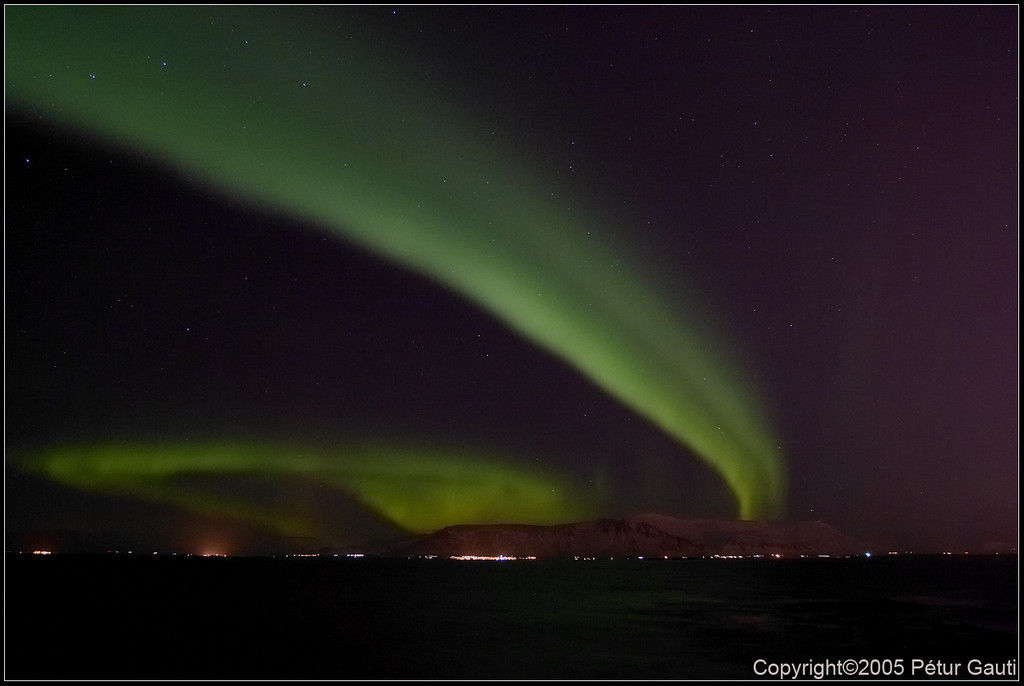 Northern Lights again. Now from Seltjarnarnes towards Reykjavík city.