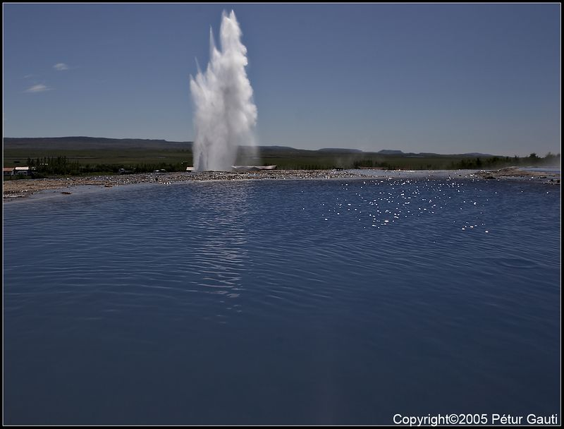 25. July. Strokkur<br /> An eruption in the geyser Strokkur. Viewed over the hotspring of Blesi.