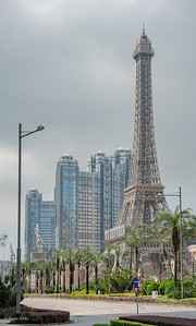 The miniature Eiffel tower in front of The Parisian Macau and behind hotel: Studio City Macau