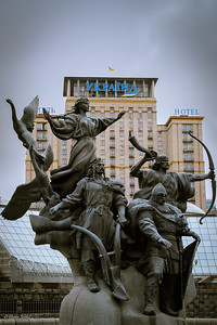 Our hotel (Ukraine Hotel) with statue of the founders of Kiev in front on independence square.