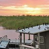 Description - Boat-tailed and Common Grackles at Sunset <b>Title - Canoe Hut at Loxahatchee</b> <i>- Kevin Kovacs</i>