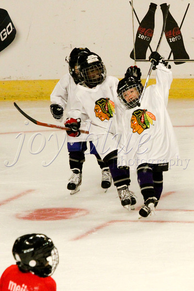 <b>Reason to celebrate Northwest Hockey League (Mites level, 7-8 years)—28 September 2011</b>  Update on last week's entry: I received a nice note from my subject's mom. She tells me that the goal I captured on the United Center ice was her son's <i>very first goal ever!</i> How cool is that?! Judging by the look on our star athlete's face, I'd say wicked-cool! I dare you not to smile, too.