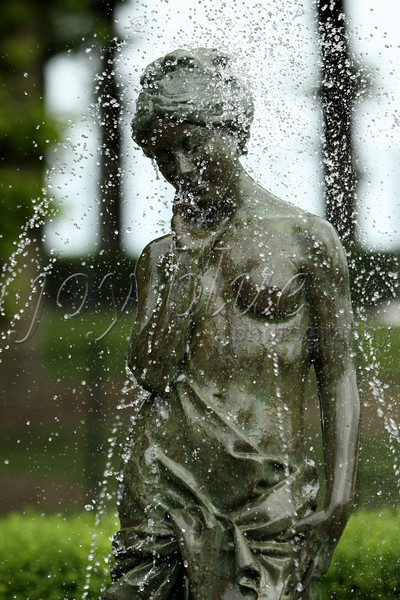 <b>Water girl—June 2011</b>  Getting a little hot out for you? How about getting soaked? I've tried, unsuccessfully, to research this fountain figure. Just for fun, Question 1 is: Do you know where I took this shot? Question 2 is: Do you know anything about the figure?