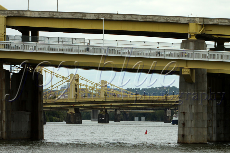 <b>Three Sisters  Downtown Pittsburgh—22 September 2014</b>  Beyond the Fort Duquesne Bridge are the Three Sisters: very similar self-anchored suspension bridges named to honor important Pittsburgh residents Roberto Clemente, Andy Warhol, and Rachel Carson. I found the historical, engineering, and political background interesting. Check it out!