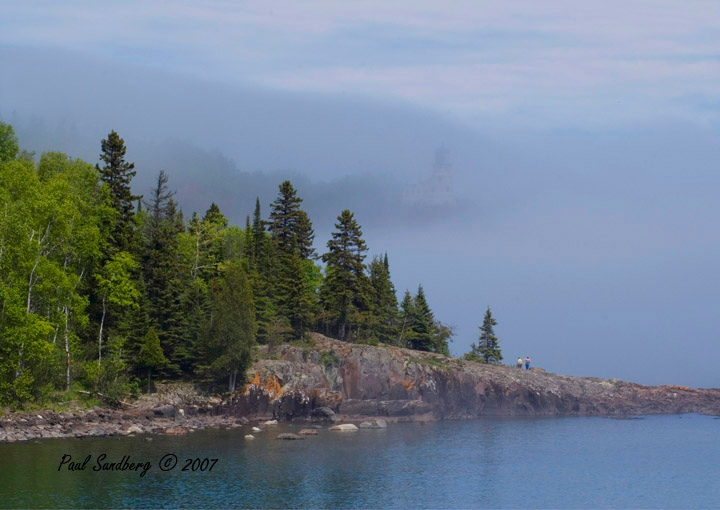 Fog Over Split Rock Lighthouse<br /> <br /> Driving in fog can get tiresome but photographing Lake Superior in fog never does.  It changes the shoreline with every passing minute.  I got up early for some foggy sunrises this past week. I was very thankful I did even though it's harder to get up for sunrises in the summer since the sun in June will rise at 5:10 AM.   The attached photos are a sunrise off the mouth of the Gooseberry River and early morning fog shadowing Split Rock Lighthouse in the distance.