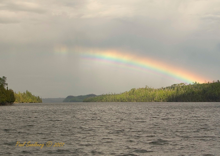 Loon Lake Rainbow<br /> <br /> As we were returning home, a beautiful rainbow appeared over Loon Lake. If not for the firefighting efforts and the much needed rain, the area around Loon would also have burned. For those thinking of heading into the Boundary Waters Canoe Area Wilderness, go. There are hundreds of beautiful lakes to explore. If you canoe through the burned area you can see new life springing up all around you. Recovery has begun.