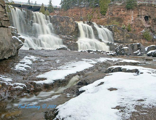 This week we received a little snow on the North Shore. It didn't stay long but it did brighten up the falls area. The attached photo shows the Middle Gooseberry Falls with a touch of snow. Even during the gray month of November the waterfalls can put a touch of color in the landscape.