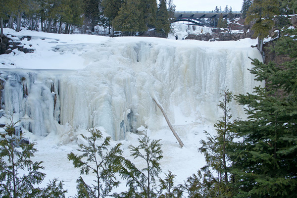 The Lower Falls on the Gooseberry River has incredible ice formations this year. The cold temperatures have caused most of the Lower Falls to freeze to the bottom. This has forced the water to run to the side of the river's normal flow pattern. In one of the spots the overhanging rocks make it possible to go behind the waterfalls.