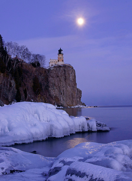 Split Rock Lighthouse State Park 001<br /> <br /> The moon was definitely in the limelight last week. Clear conditions made it possible for me to photograph the rising moon two evenings in a row. On Tuesday, the night before the full moon, there were only a few clouds on the horizon so I went to Split Rock Lighthouse State Park. Just below the lighthouse are several boulders covered in ice from the freezing spray that make a great spot from which to photograph the rising moon. The temperature was 5 degrees below zero with a strong wind putting the wind chill at -40.
