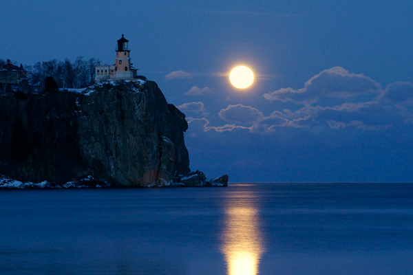 Split Rock Moonrise 001 Jan 22<br /> <br /> It was a magical evening at Split Rock Lighthouse State Park. Several people were sitting on the shore waiting to witness the rising of the full moon. The entire group was photographers. Some had done this before and lived close by and for others it was their first time and they had driven hundreds of miles. There must have been $50,000 worth of camera equipment lying on the beach.